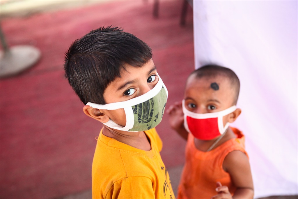 Bangladeshi child patient wears face masks to prot