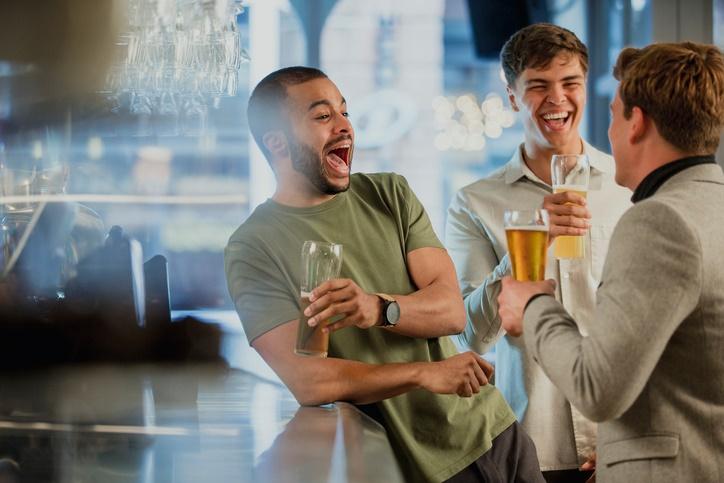 Men drinking at bar