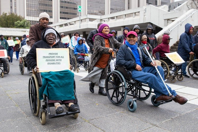 People living with disability marched from Artscape on the Foreshore to the Cape Town Civic Centre, demanding a better service from Dial-A-Ride transport and that the service extend to informal settlements. (Photo: Ashraf Hendricks)