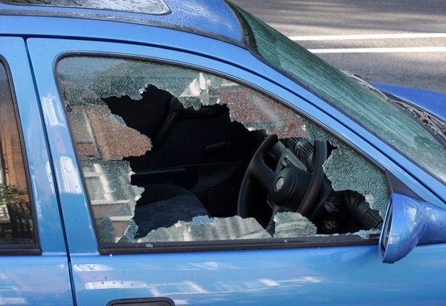 Car with smashed window.