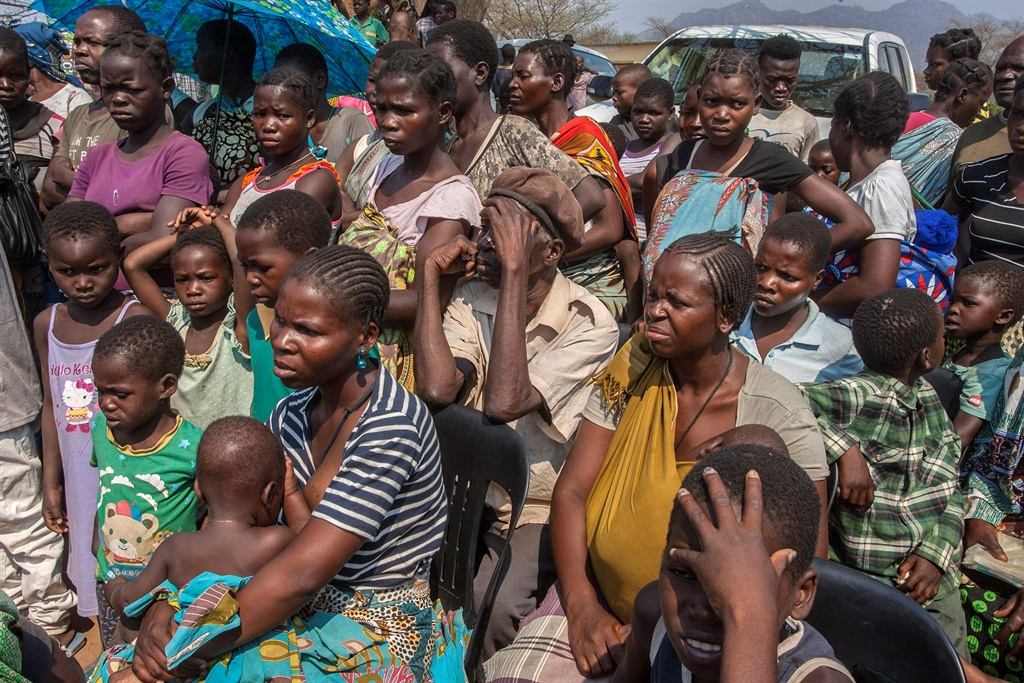 Mozambican refugees, who are opting for voluntary repatriation after fleeing conflicts between the government and opposition groups in their country, wait for registration at the Luwani Refugee Camp in Neno District, southern Malawi. (AFP)