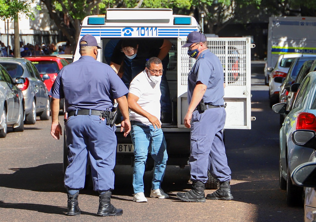 Well-placed sources revealed to News24 that Booysen (in white shirt) had been paying his respects at a funeral when a blue Mazda pulled up alongside mourners. (Adrian de Kock, Gallo Images)