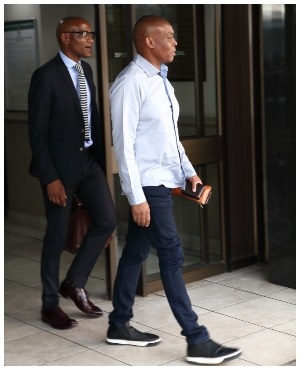 Rapulana Seiphemo walks out of court with his lawyer. (Photo: Papi Morake, DRUM)