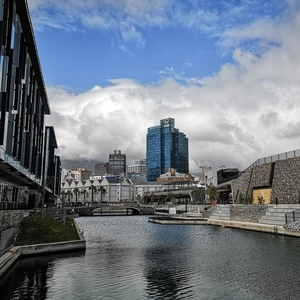 Canal in a city with skyscrapers in the background