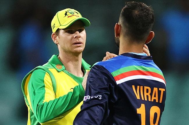 Steve Smith of Australia and Virat Kohli of India fist pump following Australia's win at the Sydney Cricket Ground on 29 November 2020.