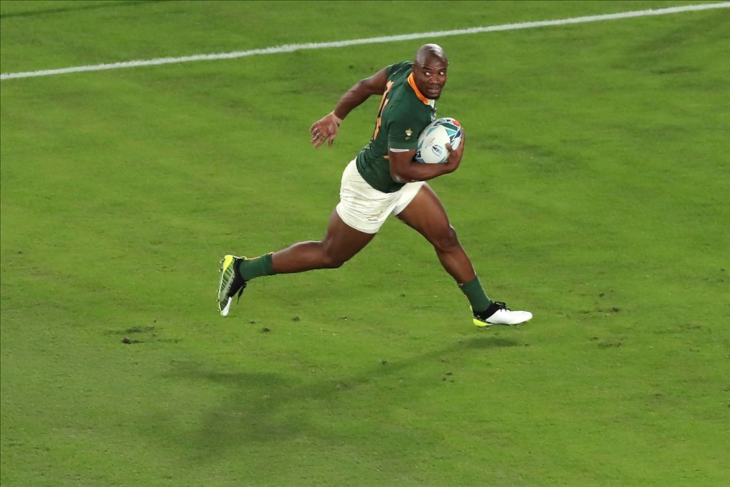 South Africas Makazole Mapimpi scores a try during