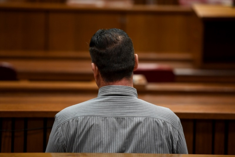 The 'Springs monster' is seen in the gallery during his trial at the North Gauteng High Court in Pretoria. (Photo by Gallo Images / Netwerk24 / Deaan Vivier)