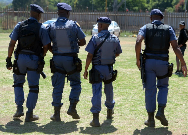 Members of the SAPS Tactical Response Team on patrol in Westbury. (Felix Dlangamandla, Gallo Images, Netwerk24)