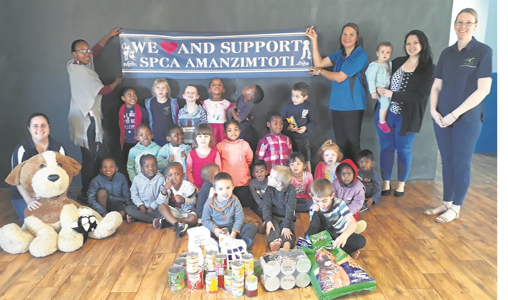 Little Sprouts staff, pupils, parents, and SPCA staff gathered with the donations for the animals.PHOTO: supplied