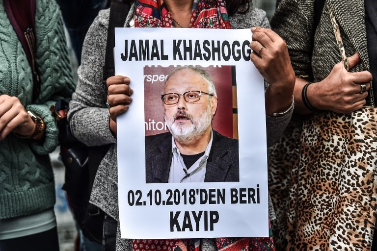 "A woman holds a portrait of missing journalist and Riyadh critic Jamal Khashoggi reading ""Jamal Khashoggi is missing since October 2"" during a demonstration in front of the Saudi Arabian consulate in Istanbul. (AFP)"