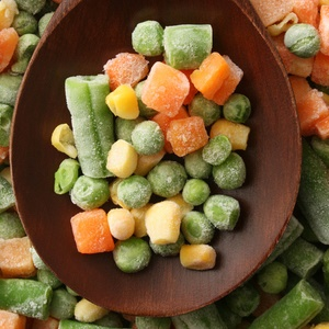 a spoon full of frozen vegetables