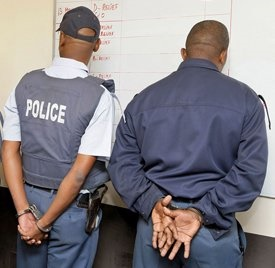 Two police officers will on Thursday appear in court on charges of murder and defeating the ends of justice.