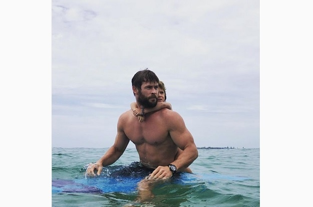 """""""On the hunt for some barrels with my little surf coach."""" chrishemsworth"""