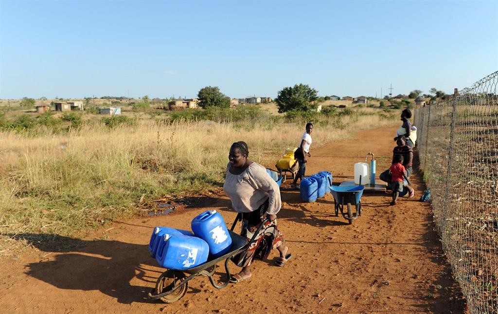 Residents of Ndabula and sorrounding villages outside Thohoyandou have to travel long distances to get water. Picture: Felix Dlangamandla