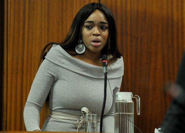Cheryl Zondi weeps as she testifies during the tri