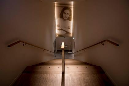 A picture of Anne Frank accompanies visitors as th