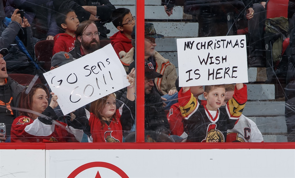 OTTAWA, ON - DECEMBER 23: Young fans hold up Chri
