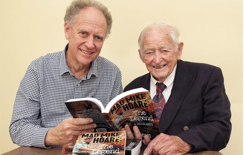 Author Chris Hoare, left, shows his father, the famous 'Mad Mike' Hoare, now aged 99 and living in Durban, a copy of his biography.PHOTO: supplied