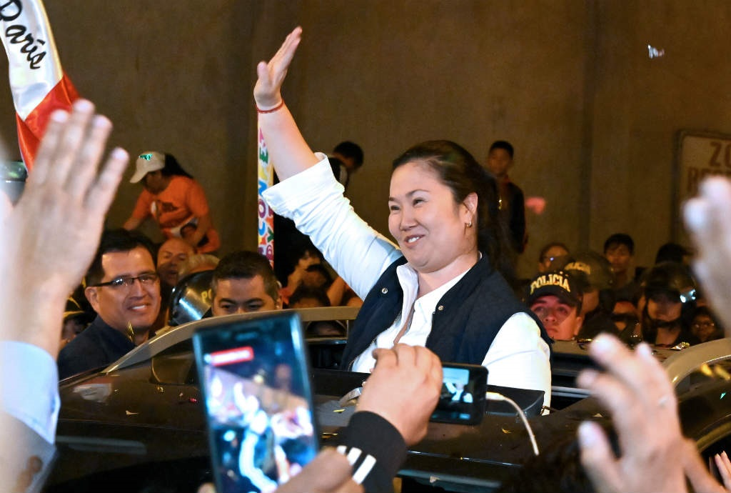 Peruvian politician Keiko Fujimori waves to supporters as she is released from prison in Lima on November 29, 2019. (Cris Bouroncle/AFP)