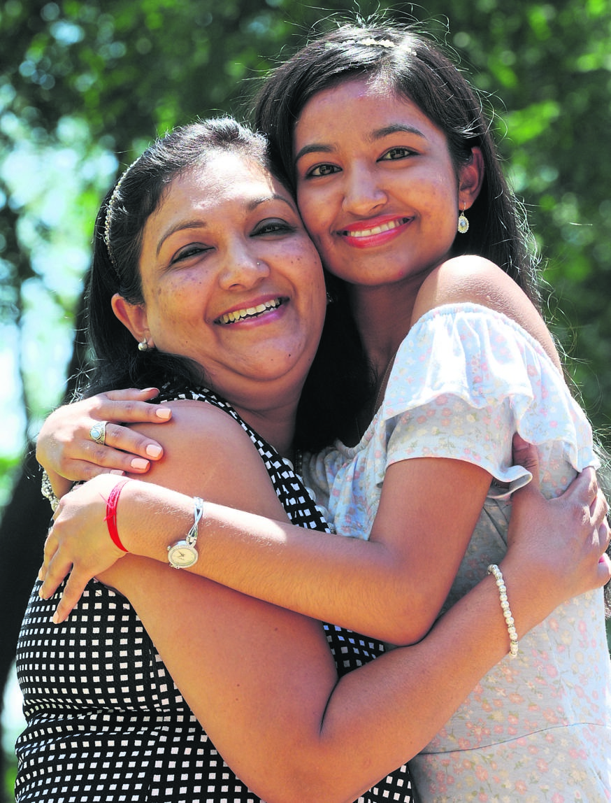 Lekha Chirkoot hugs her daughter, Kiara Singh from Carter High School, after she bagged seven As for her matric exam.PHOTO: Ian Carbutt