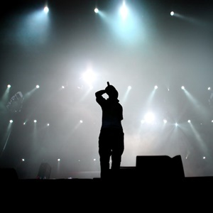 Silhouette of hip hop singer on stage.