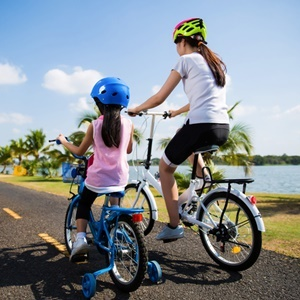 Mother and daughter were cycling at the park in th