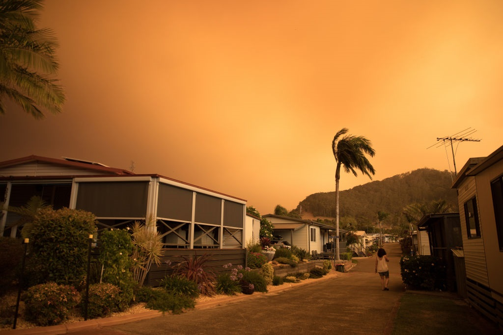 The sky is filled with smoke, and ash in Shoalhaven Heads, NSW, Australia.
