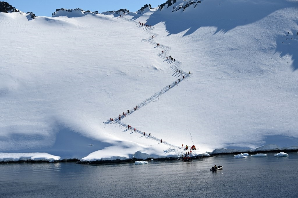 Tourists visit Orne Harbur in South Shetland Islan