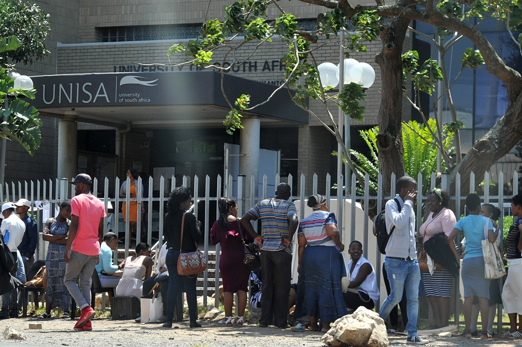 Students standing at UNISA's gate in Durban in a sunny day waiting to be helped with their registrations as university workers down the tools. Picture: Jabulani Langa