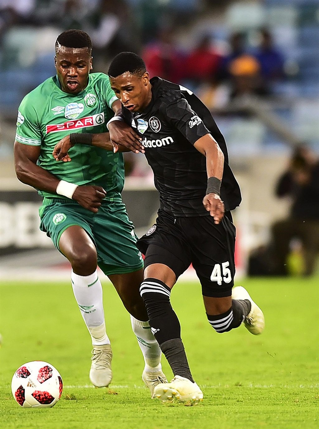 Bonginkosi Ntuli of AmaZulu fights for the ball with Orlando Pirates' Vincent Pule in a Telkom Knockout match at Moses Mabhida Stadium