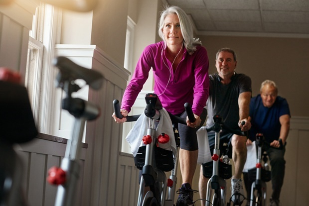 Shot of a group of seniors having a spinning class