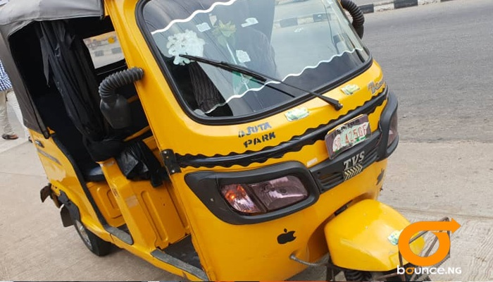 Praise is a commercial tricycle rider in Lagos