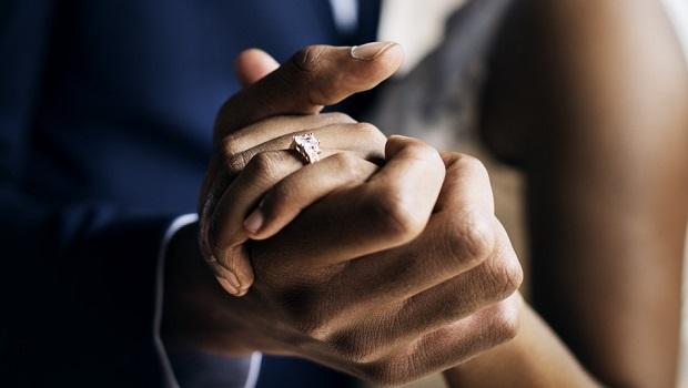 African descent couple dancing at wedding celebrat