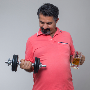 man holding beer and weight
