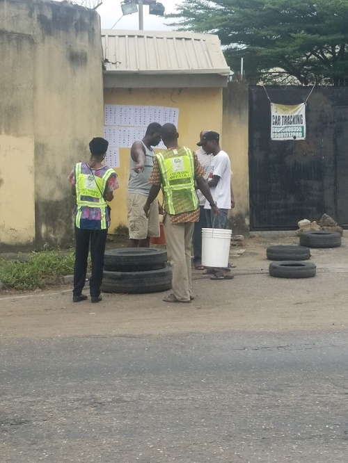 INEC officials pasting the Voters register