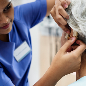 woman having hearing aid fitted