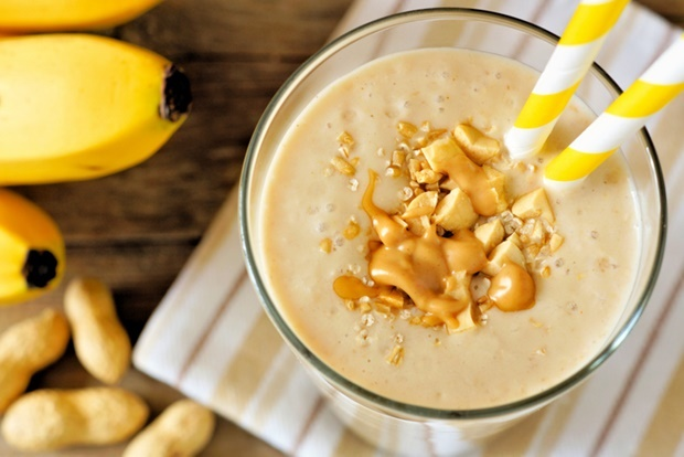 Peanut butter banana oat smoothie with paper straw