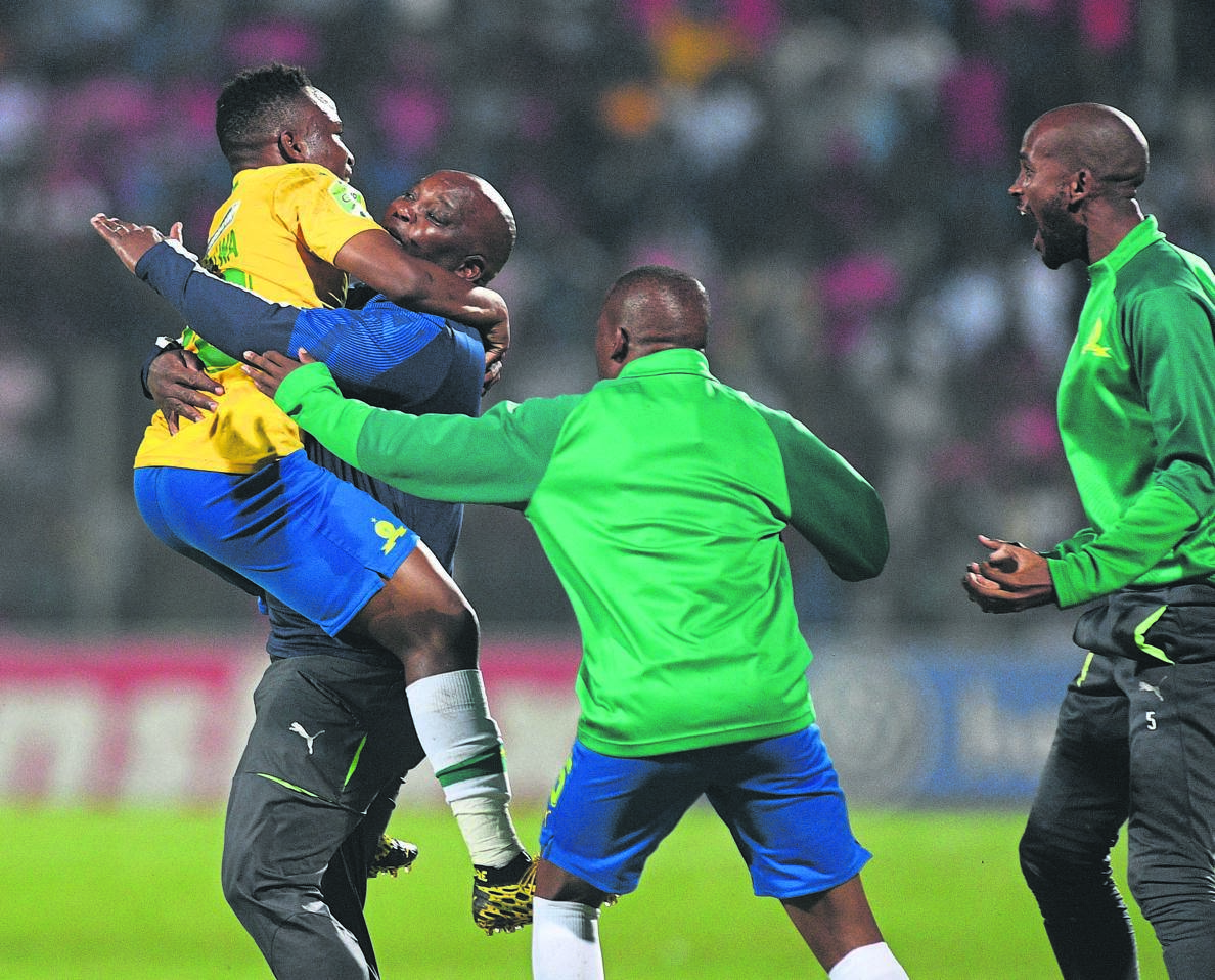 well done, my boy Keletso Makgalwa celebrates with coach Pitso Mosimane after scoring the winner against Highlands Park last night PHOTO: Sydney Mahlangu / BackpagePix