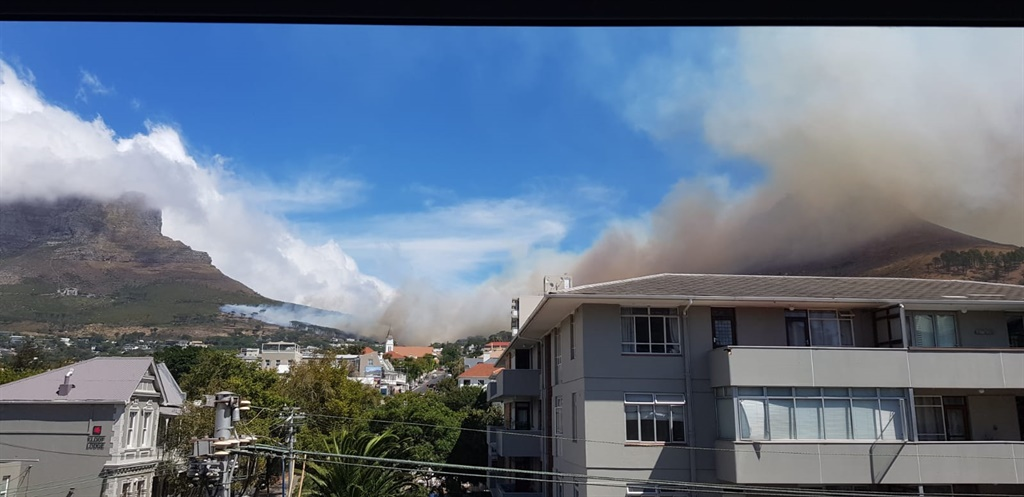 Fire and smoke seen at the bottom of Table Mountain in Cape Town on 15 March 2020.