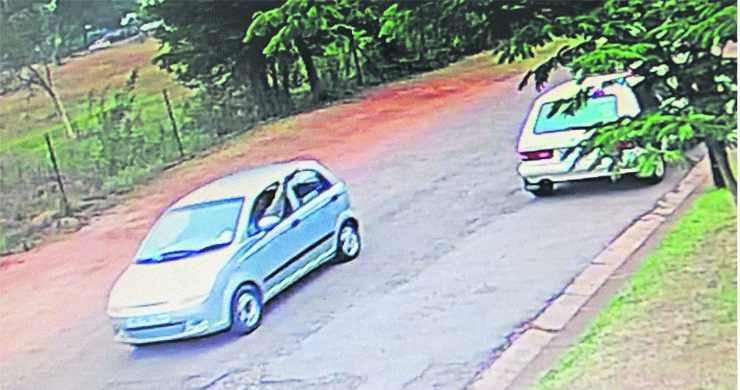 CCTV footage of a vehicle driving off with the passenger holding a firearm (circled) out of the window after an alleged robbery outside a Scottsville pre-school on Wednesday.