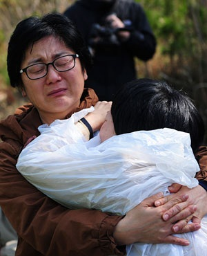 South Korean relatives of a victim of a capsized ferry react in Jindo. (Truth Leem, AFP)