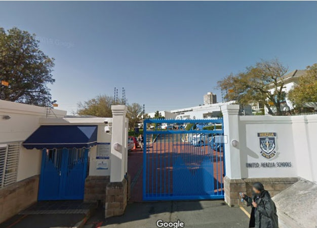 Herzlia Middle School is a Jewish school in Cape Town. Photo of entrance to school from Google Street View. (Public domain).