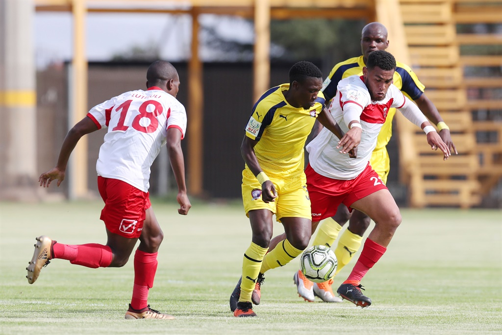 Seun Ledwaba of Jomo Cosmos challenged by  during