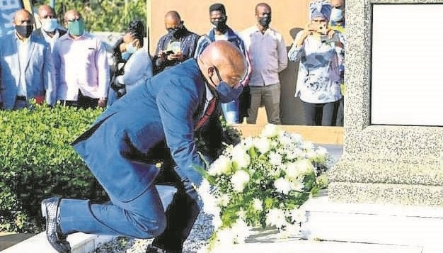 KZN Premier, Sihle Zikalala, lays a wreath at the grave of former ANC president John Langalibalele Dube in Inanda north of Durban on Tuesday.