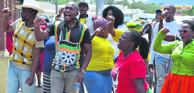 PHOTOS: siphelele nketoCommunity members chant outside Umzimkhulu Magistrate's Court, calling for an end to political killings.