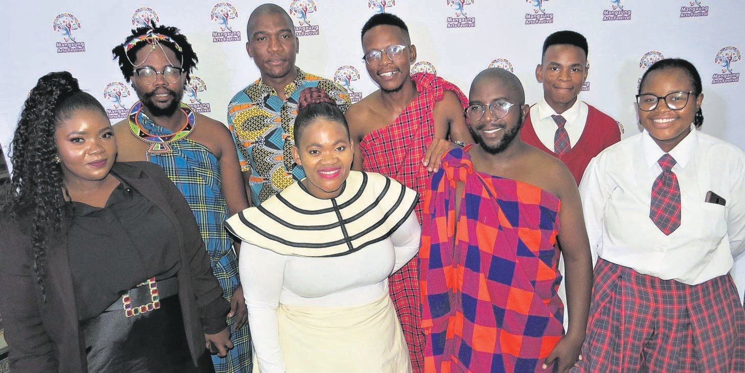 Performers and organisers of the Mangaung Arts Festival are from the left, front: Rita Chihawa (Mangaung Arts Festival director), Chamza Mrwebi, Itumeleng Stone and Amahle Booi; back: Sicelo Kgosing, Khonzeka Tyindyi (Mangaung Arts Festival coordinator), Nkululeko Mnono and Vuyolwethu Madlolo.Photo: Teboho Setena