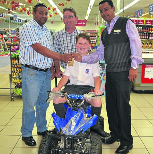 A smile on the face of Robin Krebser (middle) who is pictured with Brandon Wyne Nagaya from Parmalat (left), his father Bruce Krebser, and Pick 'n Pay Store manager Jackie Maistry (right). PHOTO: supplied