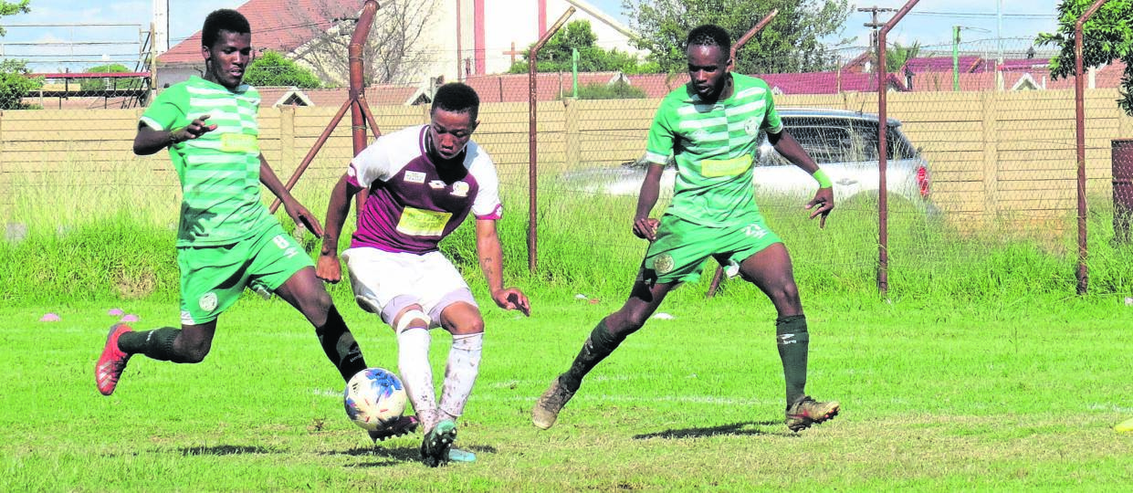 Mangaung Unite player Katleho Neels battles for the ball with Bloemfontein Celtic pair, during the teams ABC Motsepe League return fixture played at Clive Solomon Stadium on Saturday (14/03). Photo: Teboho Setena