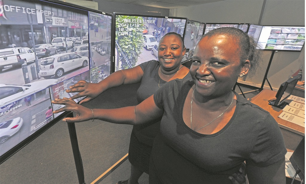 Safe City control room operators Princess Mncwabe (left) and Mary Khoza show off the Safe City system which so impressed City of Jo'burg officials last week that they are looking at running a similar system there.