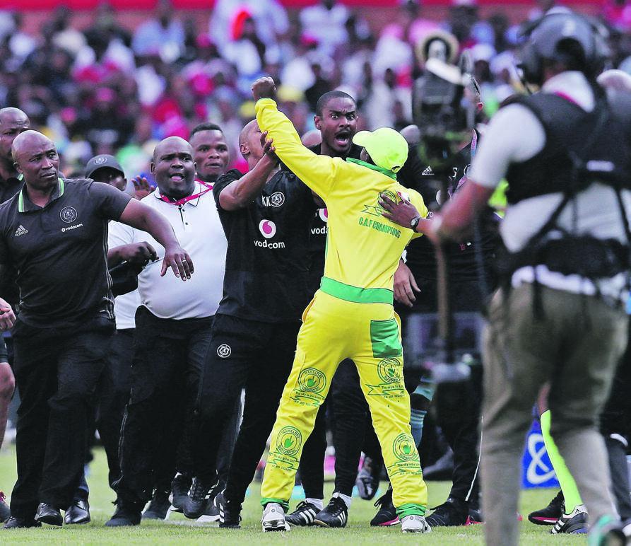 Mamelodi Sundowns fan Sello Piet Moyana attacks Rhulani Mokwena during a match against Orlando Pirates in 2018. Picture: Muzi Ntombela / BackpagePix